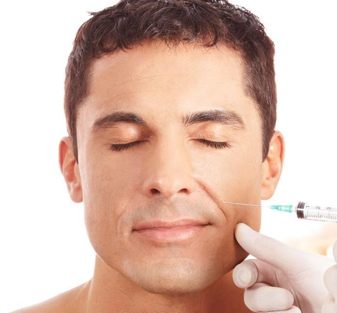 Man getting an injection on the face