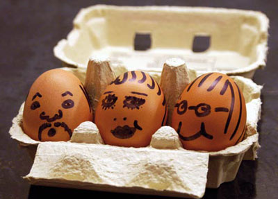 Faces drawn on three eggs