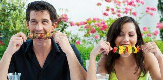 Man and woman enjoying the food