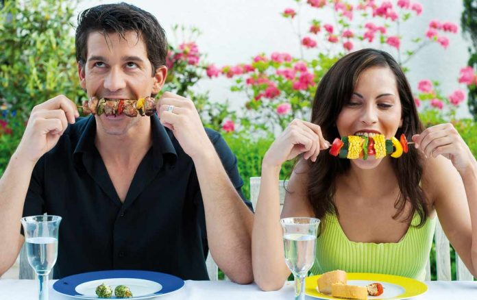 Man and woman enjoying the food