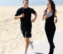 Man and woman jogging on the beach