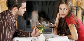 Man and woman having dinner-woman not interested