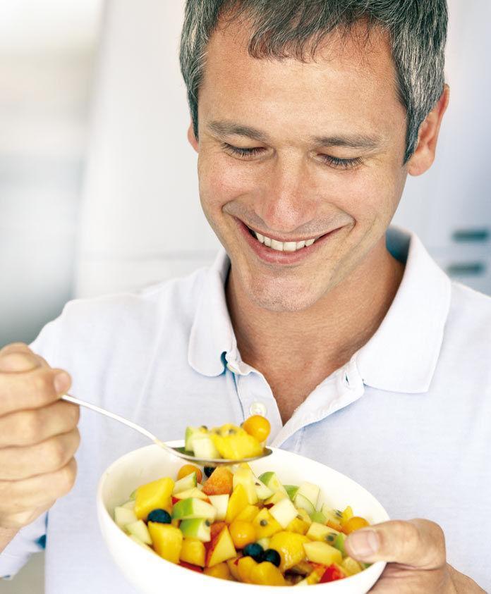 Man having fruits