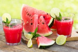 Watermelon Juice garnished with lime and mint