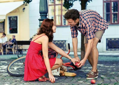 Man helping woman in her things fallen down