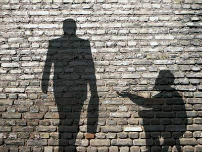 Shadow of old man begging a rich man