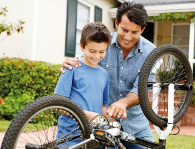 Father and son repairing a bicycle