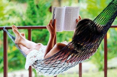 Woman enjoying reading a book
