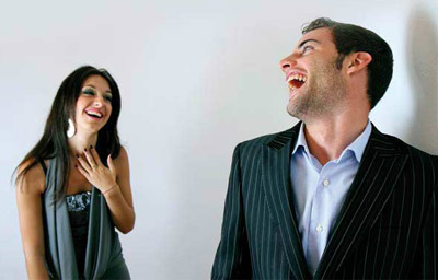 Man and woman laughing at each other
