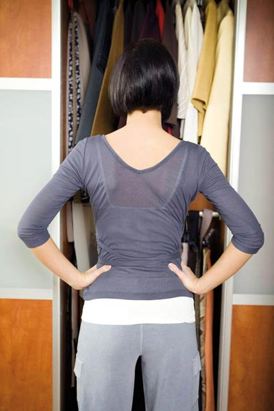 Woman standing in front of the closet
