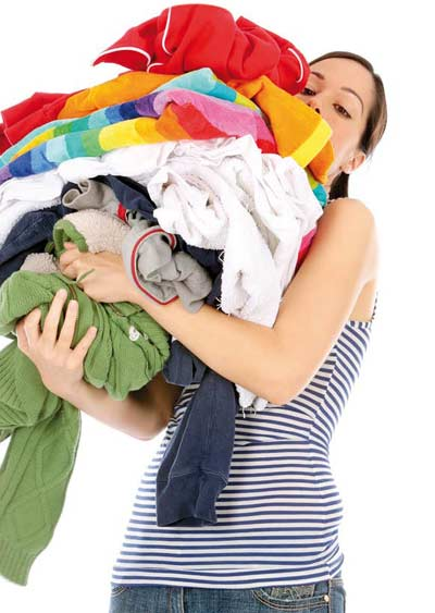 Woman with piles of clothes in her hands