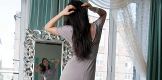 Women looking herself in the mirror