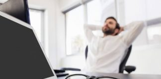 man doing progressive muscle relaxation sitting on his office chair