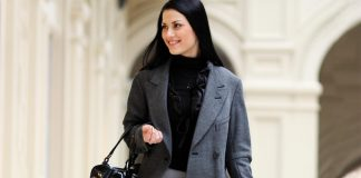 Woman dress well walking in a style with black purse
