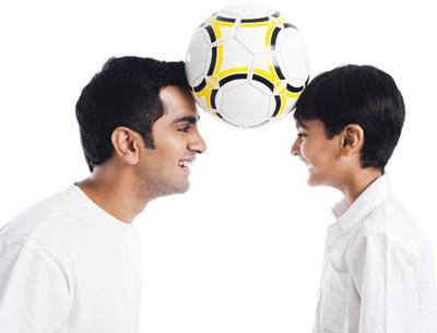 Father son enjoying football