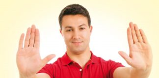 Man showing sign of no using his hands