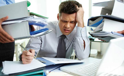 Man frustrated with loads of work