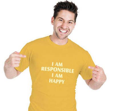 Man smiling and pointing to his T-shirt mentioned I am responsible I am happy