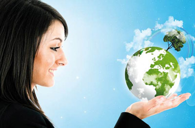 Woman holding globe with green environment