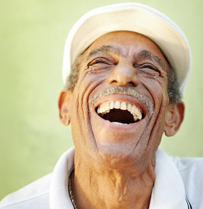 Old man with a hearty laugh
