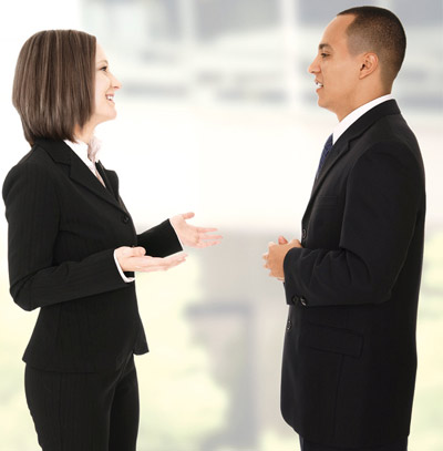 Man and woman communicating to each other at office