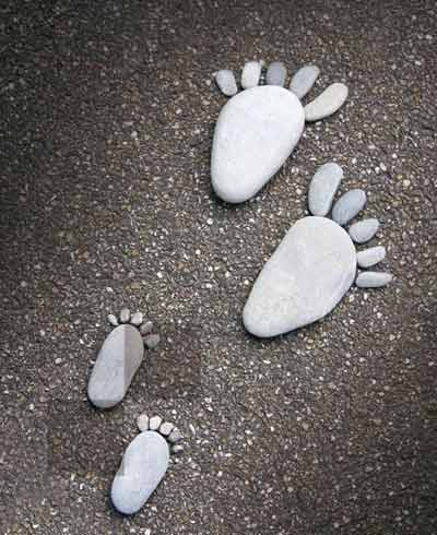 Two adult's feet and two child's feet