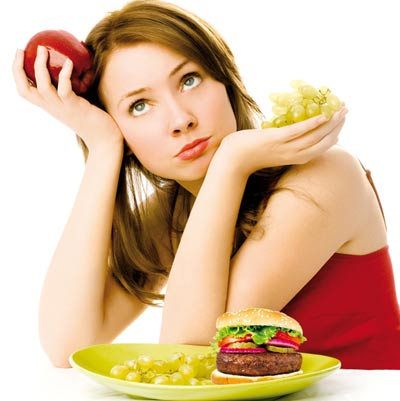 Woman thinking and eating food