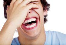 Boy having a hearty laugh
