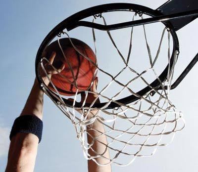 Man aiming ball in the basket