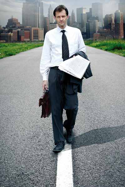 Man walking on the road to office