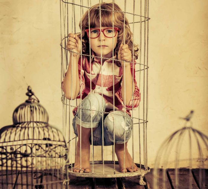 Girl trapped inside the cage