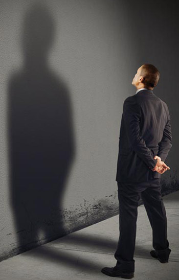 Man looking at his shadow