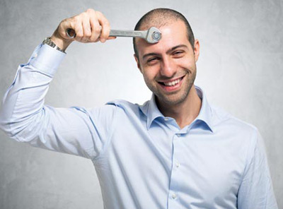 Man tightening the screw of his brain