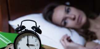 Woman lying awake at night / Night sweats concept
