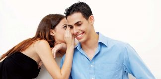 woman whispering in the ears of her husband / toxic relatinship habits
