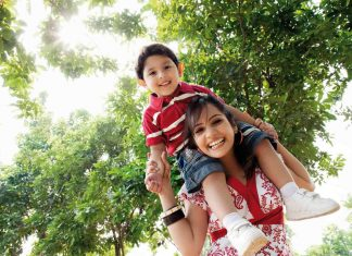 Happy mom and son outdoors / language of love