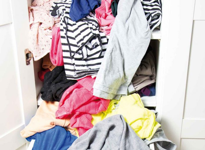 Unorganised clothes closet