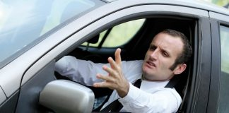 Frustrated man in car complaining about traffic