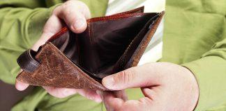 Man showing empty wallet, money mistake