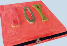 red box with joy written on top / gifting
