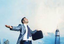 man in business suit with arms outstretched, work-life balance