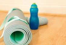 Rolled yoga mat and water bottle