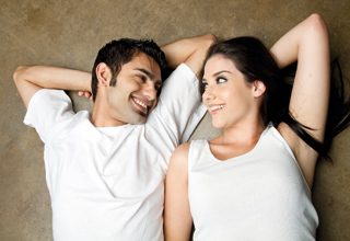 Couple laying down and smiling