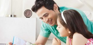 Father reading story book for the child