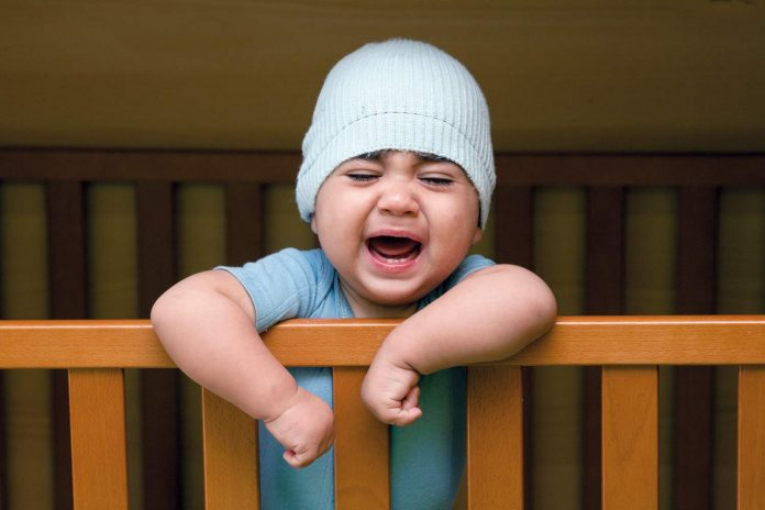 Child crying in the cradle
