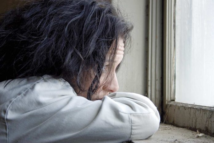 Distraught woman looking outside the window / how to move on