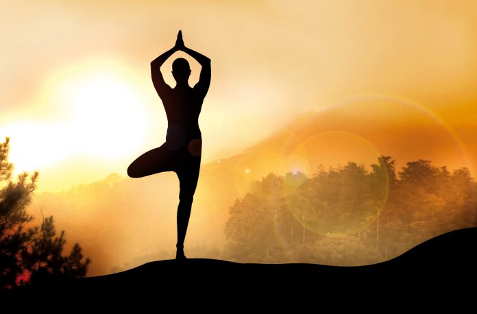 Man silhouette in yoga pose