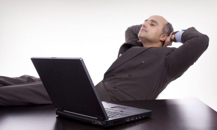 Man taking a nap while working
