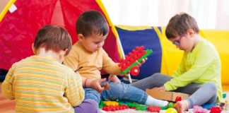 Children playing with blocks in a playschool