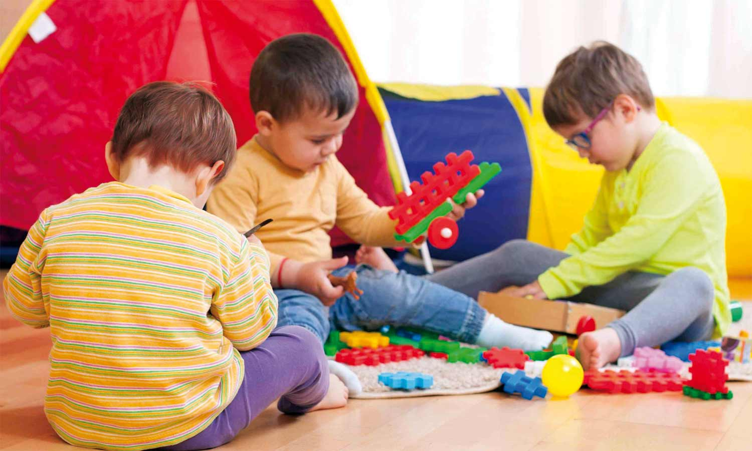 children playing with blocks in a playschool - Images Of Children Playing At School